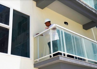 Man installing glasses on the terrace of an apartment